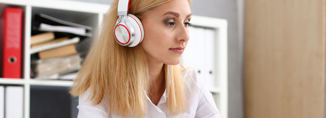 Woman with headphones, binaural beats