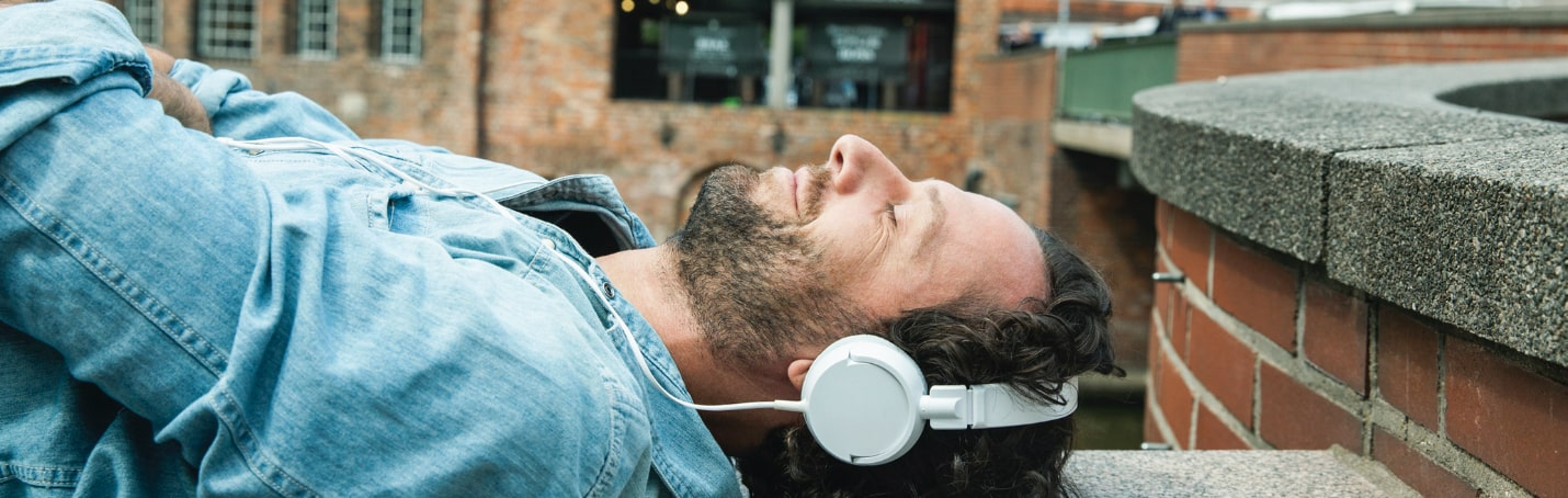 man relaxes with binaural beats