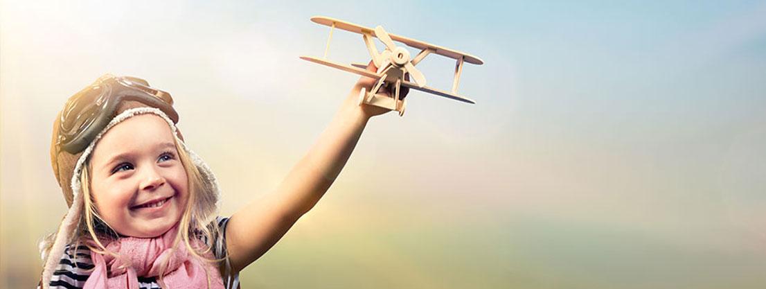 child with minature airplane