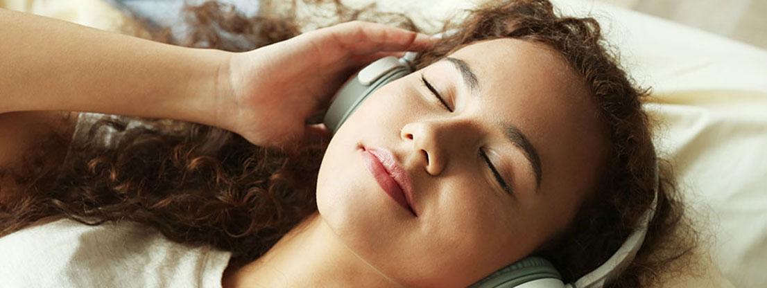 Woman listens meditation