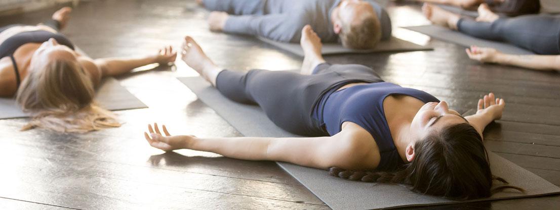 Women on yoga mats, meditation and movement