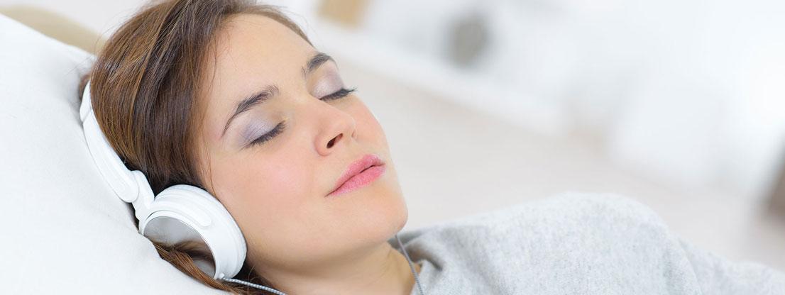 Woman sleeps with music