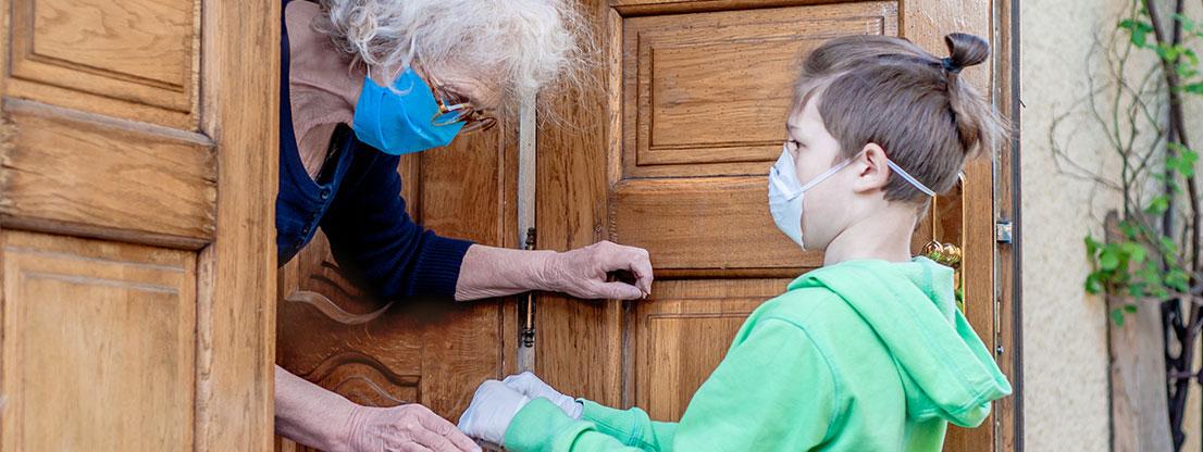 Boy helps old woman, solidarity