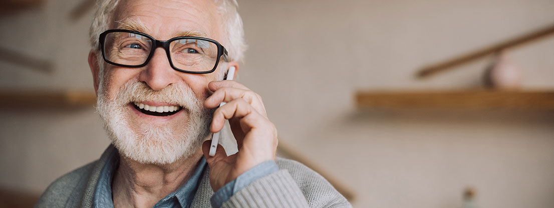 Grandpa with cell phone, joy of social attention