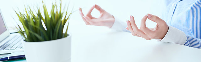 Woman meditates and relaxes at work